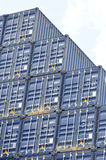 Shipping freight containers. Stacked freight containers under blue sky Royalty Free Stock Images