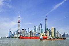 Shipping on Huangpu river with Pudong district on the background, Shanghai, China Royalty Free Stock Images