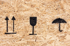 Shipping Icons On A Chipboard Container Stock Images