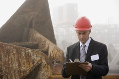A shipping inspection engineer taking notes Royalty Free Stock Photography