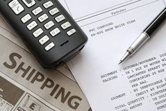 Shipping invoices and documents. Shipping invoices and newspaper with pen on related documents. For business and office life, shipping and marine industry, and Royalty Free Stock Images