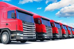 Row of cargo trucks against blue sky. Shipping, logistics and delivery business commercial concept: 3D render illustration of the row of cargo trailer rucks Royalty Free Stock Photos