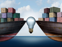 Shipping Logistics Idea. Shipping logistics or trade agreement idea with a lightbulb between two ships carrying cargo freight as a symbol for transport Royalty Free Stock Images