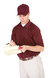 Shipping: Man Checking Delivery Papers Stock Images