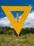 Shipping navigation yellow triangle sign on land Royalty Free Stock Photography