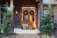 Shipping packages on porch during holiday season royalty free stock photo