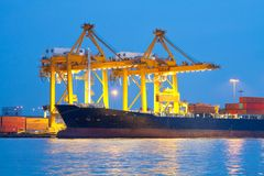 Shipping port. Industrial shipping port on sunset in Bangkok, Thailand royalty free stock photos