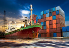 Shipping port. Business vessel at shipping port with industrial container on sunset background stock photos