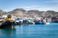 Shipping Port in Cartagena, Spain. Shipping Port with mountain backdrop in Cartagena, Spain royalty free stock image