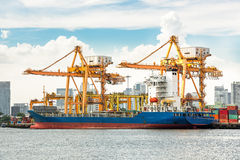 Shipping port. With crane for container uploading stock image