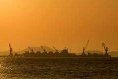 Shipping port in the sea with sunset sky Stock Images