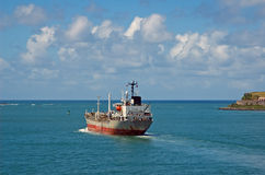 Shipping on the  seas. Cargo ship heads out of port of San Juan Royalty Free Stock Photos