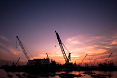 Shipping sector - industrial cranes at sunset Royalty Free Stock Photo