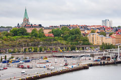 Shipping terminal and old Sofia Church, Stockholm Royalty Free Stock Images