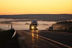 Shipping Truck at Dusk with Fog Royalty Free Stock Photography