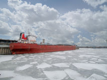 Shipping vessel frozen in harbour Stock Photos