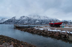 Shipping vessel in Kvaloya village in Norway Royalty Free Stock Images
