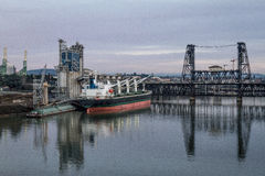Shipping Willamette River. Shipping vessel on Willamette River in front of steel bridge Stock Images