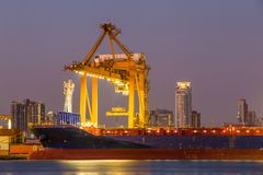 Shipping working loading containers. By crane in ship on the night Royalty Free Stock Photography