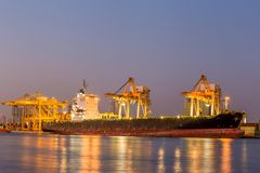 Shipping working loading containers. By crane in ship on the night Stock Images