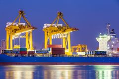 Shipping working loading containers. By crane in ship on the night Royalty Free Stock Photo
