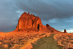 Shiprock - New Mexico. Shiprock is a monadnock rising nearly 1,583 feet above the high-desert plain of the Navajo Nation in San Juan County, New Mexico, United royalty free stock photo