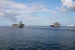 Ships. Cruiseship and cargoship on the ocean stock photography