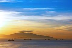 Ships at anchor at dawn Stock Image