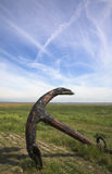 Ships anchor rusting. On the shore in vast landscape Stock Photo