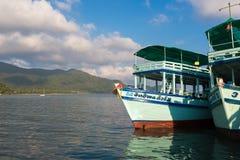 Ships anchored at the pier of Bang Bao village. Koh Chang island Stock Photo