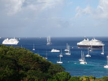 Ships arriving on new year's eve. Cruise ships and yachts anchoring in admiralty bay on new year's eve 2013 royalty free stock photo