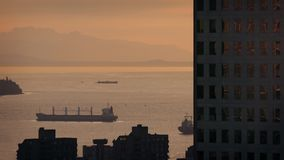 Ships In The Bay Near City Buildings At Sunset stock video