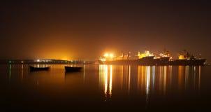Ships and boats at night. Ships and their smaller cousins boats at Varna's lake at 22:00 o' clock Royalty Free Stock Images