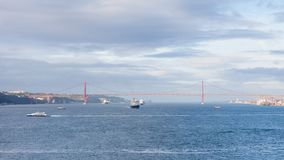 Ships and Boats Traverse the River Tagus. Beside the port of Lisbon in Portugal Royalty Free Stock Images