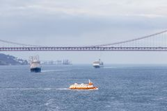 Ships and Boats Traverse the River Tagus. Beside the port of Lisbon in Portugal Royalty Free Stock Photography