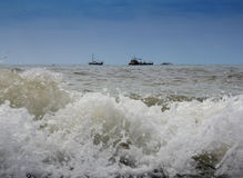 Ships and boats wait out the excitement of the high seas.  Stock Photography