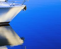 Ships bow and reflection, white & blue Royalty Free Stock Image