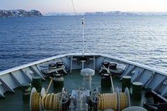 Ships bow snow mountain rocks sailing towards morning Stock Images