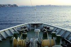 Ships bow snow mountain rocks sailing towards Royalty Free Stock Photos