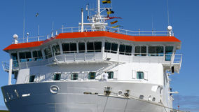 Ships Bridge. A view of the front of a modern ferry and the bridge, note the crew member painting Stock Images