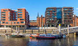 Ships and buildings in Hamburg. Ships and buildings in Hafencity quarter in Hamburg, Germany Royalty Free Stock Photo