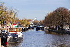 Ships in canal with lifting bridge Stock Images
