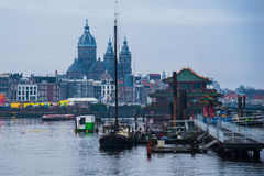 Ships on the canals in Amsterdam. City landscape. Winter season royalty free stock images