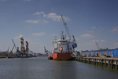 Ships with cargo cranes in the harbor Royalty Free Stock Photography
