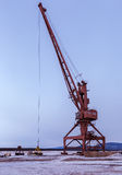 Ships cargo cranes on shore of Lake Baikal in winter. Royalty Free Stock Photo