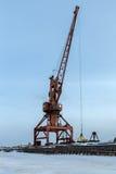 Ships cargo cranes on shore of Lake Baikal in winter. Stock Photography