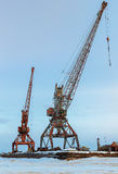 Ships cargo cranes on shore of Lake Baikal in winter. Royalty Free Stock Image