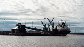 Finnish ship in the cargo port during cargo operation. Ship working on gasoil royalty free stock image