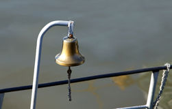 The ships copper bell on board Stock Photo