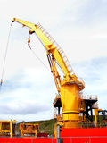 Ships Crane. A crane working on an oil rig supply vessel Royalty Free Stock Images
